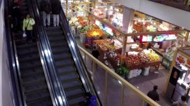 Top shot of customer buying foods and taking escalator inside Chinese Supermarket — Stock Video