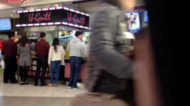 People line up for buying food at food court area inside Burnaby shopping mall — Stock Video