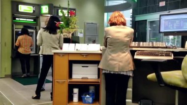People line up for withdraw money at ATM machine inside TD Bank. — Stock Video