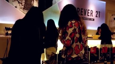 Shopper line up at check out counter inside Forever 21 store in Burnaby BC Canada. — Stock Video