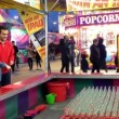 Carnival game of throwing rings over bottle necks at the West Coast Amusements Carnival — Stock Video #70748309