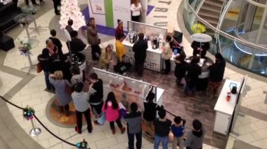 Top shot of people line up for free coffee inside shopping mall in Burnaby BC Canada. — Stock Video