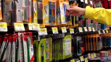 Woman choosing pens inside Walmart store in Burnaby BC Canada. — Stock Video