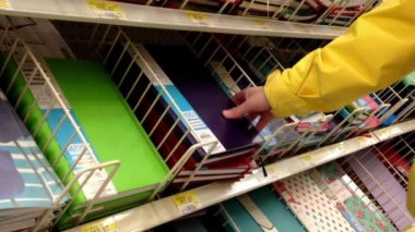 Woman choosing notebook inside Walmart store in Burnaby BC Canada. — Stock Video