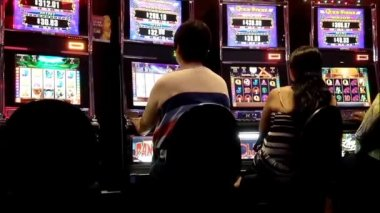 One side of people playing slot machine inside Hard Rock Casino in Coquitlam BC Canada — Stock Video