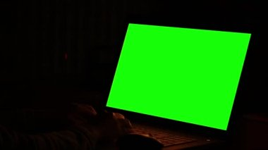 Woman working at night in front of green monitors — Stockvideo