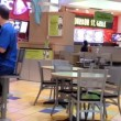 People eating foods at mall food court area in Coquitlam shopping center — Stock Video #72294037