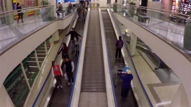 People taking escalator to superstore inside shopping mall with wide angle shot — Stock Video