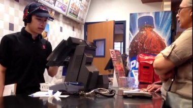 People ordering food at KFC check out counter in Coquitlam BC Canada. — Stock Video