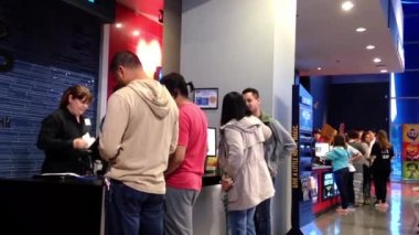 People line up for buying vip movie ticket at cinema — Stock Video