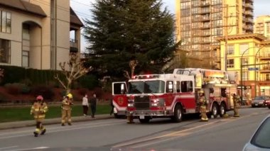 Fire Truck stopped on road battling apartment complex fire — Stock Video