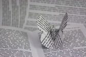 Origami butterflies coming out of a book — Stock Photo