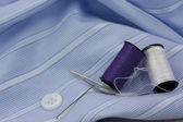 Sewing cotton needle and pins — Stock Photo