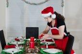 Teenage Girl Lighting Candle for Holiday Dinner  — Stock Photo
