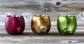 Bright Candle cup holders on aged wood  — Stock Photo