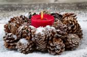 Holiday Wreath with Red Candle on aged Wood  — Photo
