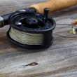Close up of Fly Reel and Flies on Wood  — Stock Photo #60019475