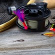 Close up of Fly Reel with fly jig hanging from spool  — Stock Photo #60019479