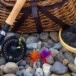 Fishing Equipment on River Bed Stones — Stock Photo #60158933