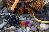 Fishing Equipment on River Bed Stones  — Stock Photo