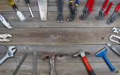 Circle of Tools on Rustic Wooden Boards  — Stockfoto