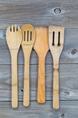 Used wooden cooking utensils on old wood  — Stock Photo