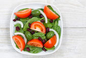 Close up Top View of Fresh Salad in plate on White wood — Stock Photo
