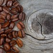 Fresh Roasted Coffee Beans on Rustic Wood — Stock Photo #61396573