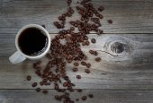 Dark Coffee and beans on rustic wood with slight vignette border — Stock Photo