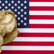 Worn baseball glove and ball on American Flag  — Stock Photo #65215513