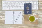 Office Desktop with USA Passport and green tea  — Stock Photo