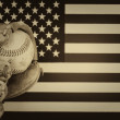 Worn baseball glove and used ball on American Flag  — Stock Photo #69482387