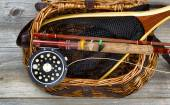 Creel filled with trout fishing equipment — 图库照片