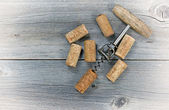 Vintage wine corkscrew with used corks — Stock Photo