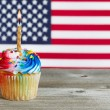Cupcake decorated in Fourth of July holiday colors — Stock Photo #70161993