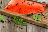 Close of cold smoked salmon on wooden server ready to eat  — Stock Photo