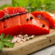 Fresh Copper River Salmon fillets on rustic wooden server with s — Stock Photo #76566801