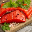 Fresh bright red Copper River Salmon fillets on rustic wooden se — Stock Photo #76635905