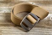 Utility nylon belt with buckle on rustic wooden boards — Stock Photo