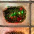Snowy Windows with red ornament hanging on fir tree with glowing — Stock Photo #78972014