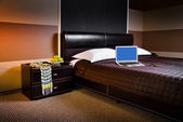 Laptop on bad in hotel room — Stock Photo