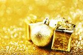 Christmas ball and gifts — Stock Photo