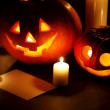 Halloween pumpkins with candles and card — Stock Photo #54281119