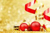 Christmas balls and ribbons — Stock Photo