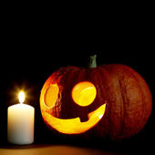 Halloween pumpkin and candle — ストック写真
