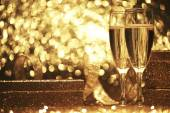Champagne glasses with gift boxes — Stock Photo