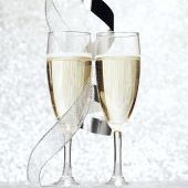 Champagne and bow — Stock Photo