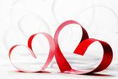 Red hearts of ribbon — Stock Photo