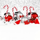 Christmas decorations in snow — Stock Photo