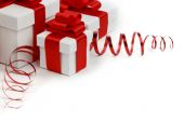 Gifts in white boxes with red ribbons — Stock Photo